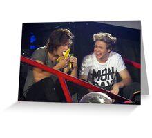 Harry enjoys a banana while Niall enjoys watching Harry eat said banana. Greeting Card