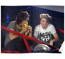 Harry enjoys a banana while Niall enjoys watching Harry eat said banana. Poster