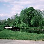 Barge on canal Somme valley France 198405080075m by Fred Mitchell