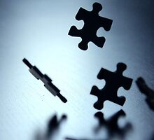 Falling jigsaw pieces by sanham