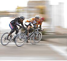 Cyclists Speeding into the Next Curve Photographic Print