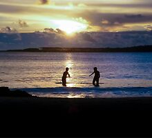 Childrens Playing in the Sea at Sunset by DFLCreative