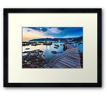 Sunset at wooden bridge Framed Print