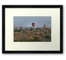Ballons ride over temples of Bagan Framed Print