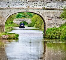 Longboat Through the Arches by Sue Martin
