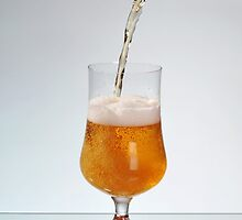 Fresh beer filling glass by Arletta Cwalina