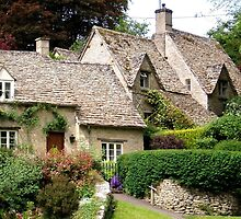 Arlington Row Cottages in Bibury UK by GeorgeOne