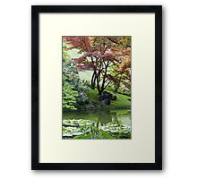 tree on the lake Framed Print