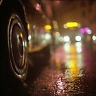 Cars in urban street on rainy night hasselblad medium format analog film photograph by edwardolive