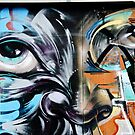 Abstract Graffiti Face on the textured brick wall by yurix