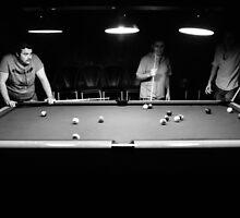 Boys playing pocket billiards by saaton