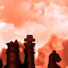 chess pieces isolated against red sky by morrbyte