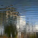 City reflection by Jeannine St-Amour