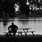 A man, a fishing pole, a duck, and a lake by Scott Mitchell