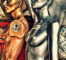 Bronze and silver female mannequins in storage. by cherylkerkin