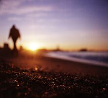 Man walking on beach at sunset square color analogue medium format film Hasselblad photograph by edwardolive