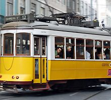 Yellow tram of Lisbon - Portugal by Arie Koene