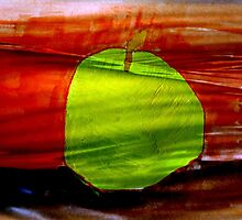 Green apple on red background by JoAnnFineArt