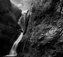 Fast Flowing Waterfall B&W by MarcoBell