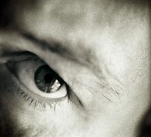 Closeup of eye of man black and white sepia tone 35mm silver gelatin analog portrait macro photograph by edwardolive
