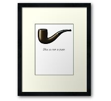 This is not a pipe Framed Print