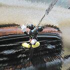 Mickey bites the Dash by nastruck