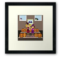 little girls in suits of the witch among pumpkins celebrate a Halloween Framed Print