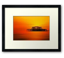Sunset over West Pier, Brighton. Framed Print