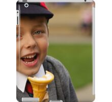 Close-up of laughing uniformed schoolboy eating ice-cream iPad Case/Skin