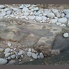 On the beach, pebbles and rocks by Vanella Mead