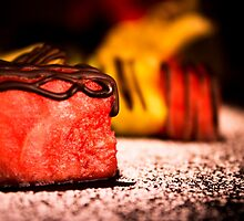 Juicy watermelon covered with black chocolate by GemaIbarra
