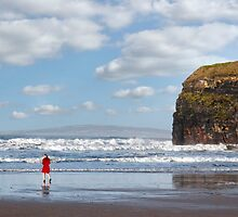lady in red with high heels on beach by morrbyte