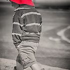 A Little Boy in a Red Hat by Clare Colins