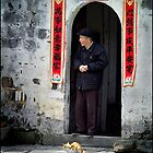 Old man & cat, Hongcun, China 2006 by John Tozer