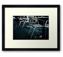 At empty chairs and empty tables Framed Print