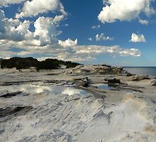 Panoramic slice of Australia with water pool and dramatic clouds by Donny Ocleirgh