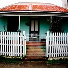 Picket fenced house with rusty roof by AquaMarina