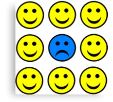 Sad Smiley Face in a Crowd of Happy Smilies Canvas Print