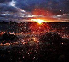 Wind sprayed sunset by JeffreyG