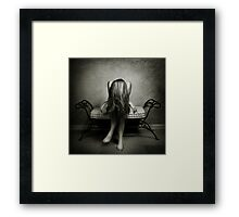 A wall, a chair and a girl... Framed Print
