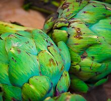 Closeup on Fresh green artichokes in the market, organic vegetables background by Stanciuc