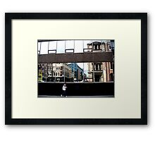 lone figure in City Framed Print