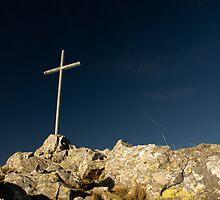 summit cross on deep blue sky by peterwey