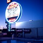 Vegas motel pool evening by laurencedodd