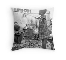 Street kids playing 'skippy' with disused iron bar, Democratic Republic of Congo Throw Pillow