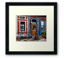 Bicycle with building Framed Print