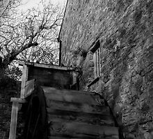 Water Wheel at 17th century water mill by imageworld