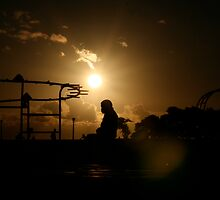 Woman Silhouette on merry-go-round by kimwild