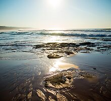 Waves On A Rocky Beach With Blue Skies by TheMadame