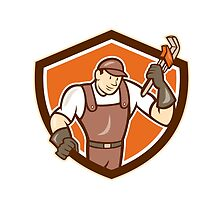 Plumber Holding Monkey Wrench Shield Cartoon by patrimonio